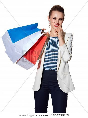 Portrait Of Pensive Woman With French Flag Colours Shopping Bags