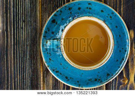 Coffee with milk, cappuccino in a blue retro cup. Studio Photo