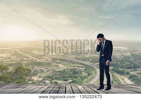 businessman feel sad and look down