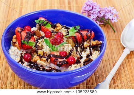 Oatmeal with Raisins, Walnuts and Strawberries Studio Photo