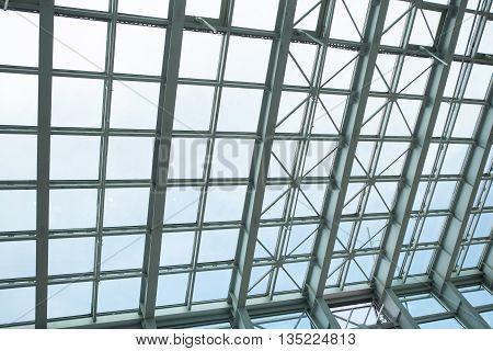 All-over glazing transparent roof of a contemporary building under bright sky