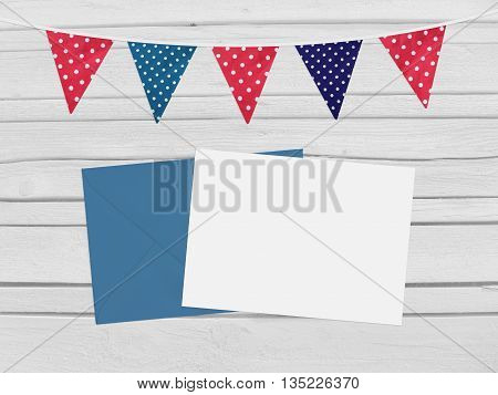 Birthday baby shower mockup scene with envelope blank card party flags. Wooden background. Empty space for your text top view.