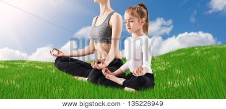Young woman and her daughter doing yoga exercise outdoors