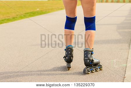 Holidays active lifestyle freedom concept. Young fit woman on roller skates riding outdoors on sea coast girl rollerblading on sunny day