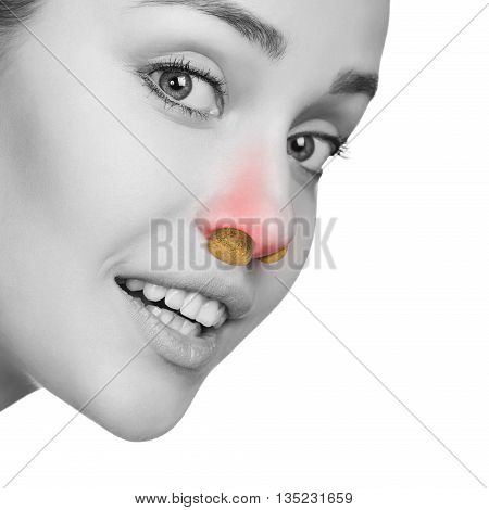 Young woman with sinus pressure and bung in nose isolated on white