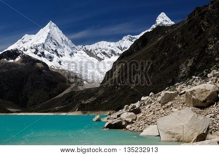 South America Beautiful Cordillera Blanca mountain. The picture presents lagoon Paron and snowcovered Piramide de Garcilaso peak Peru