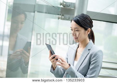 Businesswoman use of cellphone