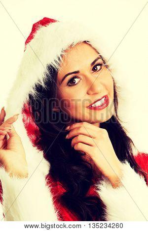 Smiling santa woman touching her hat