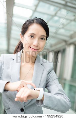 Business woman use of wearable watch