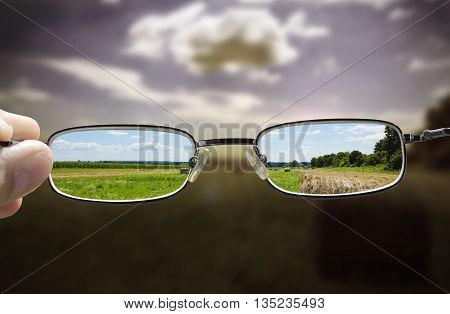 concept looking through glasses turns a gloomy day into a sunny one
