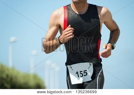 Running triathlon athlete man,running on triathlon race on sunny days
