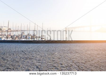 empty floor with sail boats on tranquil sea at sunrise in san francisco