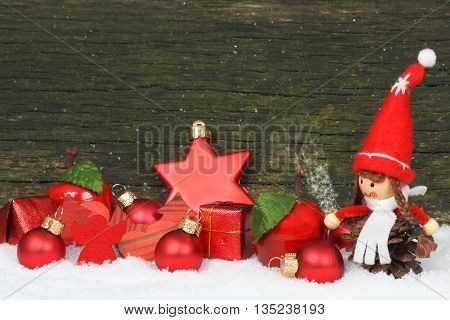 Christmas decoration with star in front of wood