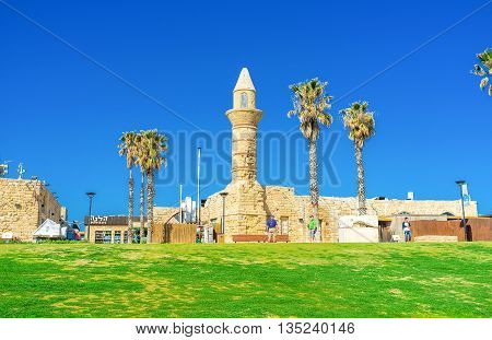 CAESARIA ISRAEL - MAY 19 2016: The medieval stone minaret of the mosque rises over the archaeological site on May 19 in Caesaria.