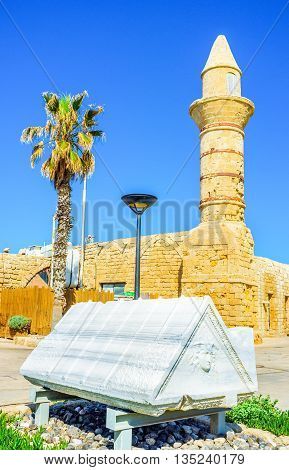 The scenic marble sarcofagus cover with the relief of Medusa located next to the medieval mosque in Caesaria Israel.