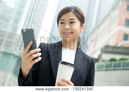 Business woman reading on cellphone