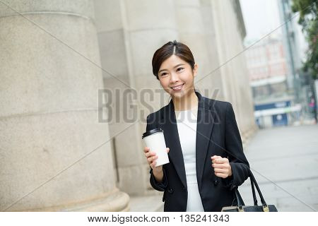Young Businesswoman holding a coffee cup