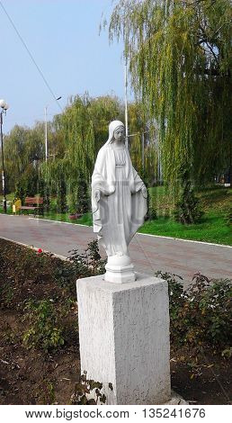 Lonely Madonna statue in a city park