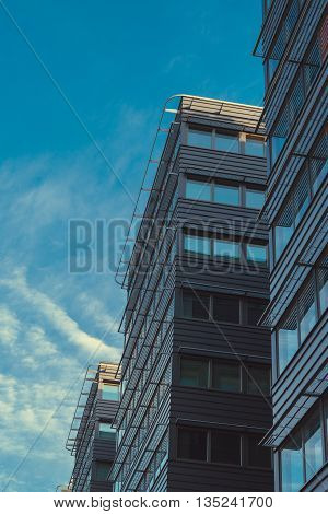 Modern office buildings in a row by the morning light business concept toned image