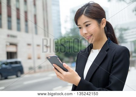 Asian Businesswoman looking at mobile phone