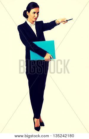 Businesswoman pointing by pen