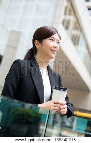 Business woman hold with coffee cup