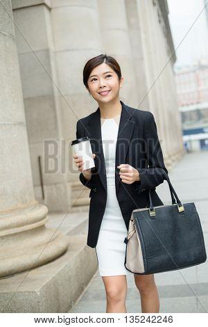 Business woman walking outside