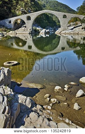 Reflection of Devil's Bridge in Arda river and Rhodopes mountain, Kardzhali Region, Bulgaria