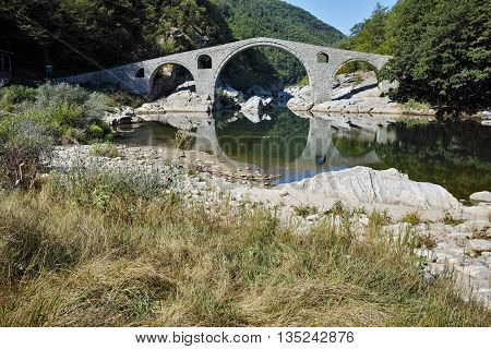 Reflection of Devil's Bridge and Rhodopes mountain in Arda river, Kardzhali Region, Bulgaria