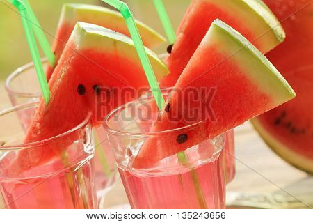 fresh juice of watermelon  in glasses outdoors