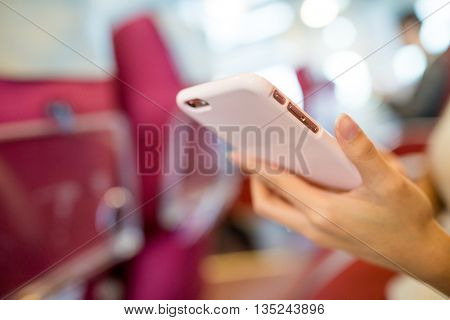 Woman using cellphone on ship