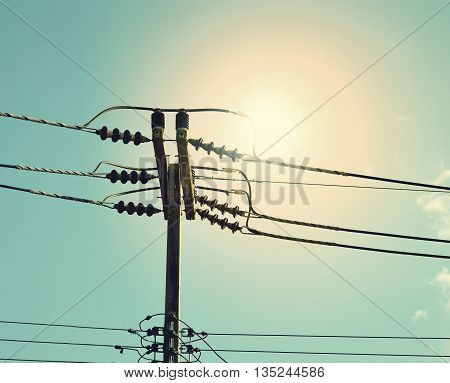 high voltage post.High-voltage tower at sky background.