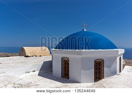 Blue roof of church and Panoramic view to Santorini island, Thira, Cyclades, Greece