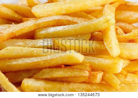 Golden delicious fries close up, may be used as background