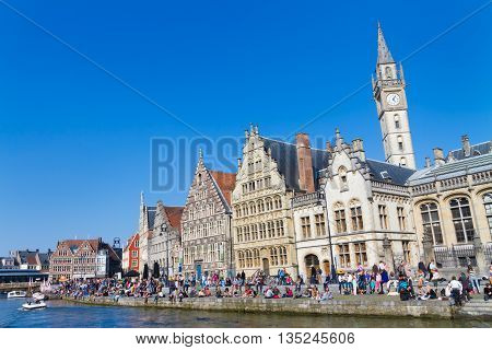 Ghent, Belgium - 21 April, 2013 : People gathered on the banks of the river Leie enjoy a sunny Sunday afternoon in Ghent, Belgium on 21 April 2013.