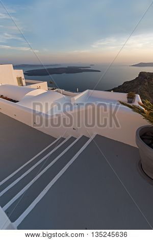 Amazing sunset view from town of Imerovigli to volcano, Santorini island, Thira, Cyclades, Greece