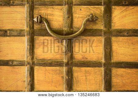 Old rusty door handle for stripping wallpaper.