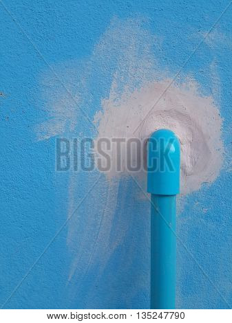 pvc pipe on blue cement wall texture