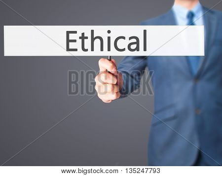 Ethical - Businessman Hand Holding Sign