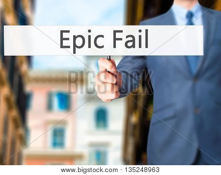 Epic Fail - Businessman Hand Holding Sign