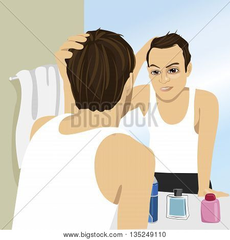 Young man worried about hair loss while looking in a mirror