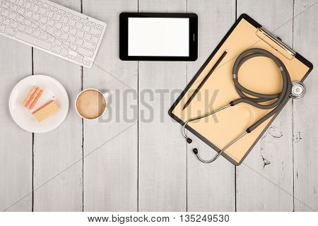 Workplace Of Doctor - Stethoscope, Clipboard, Tablet Pc, Keyboard Of Computer, Cup Of Coffee