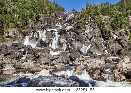 Rainbow at Uchar waterfall, Altay (Altai), Russia