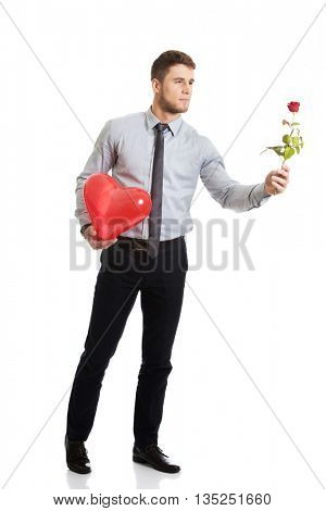 Man with red rose and heart balloon.