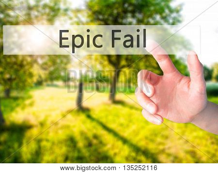 Epic Fail - Hand Pressing A Button On Blurred Background Concept On Visual Screen.
