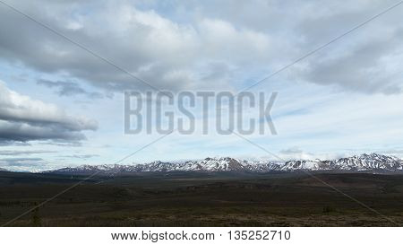 Clouds over snowcapped mountains in Alaska's Denali National Park