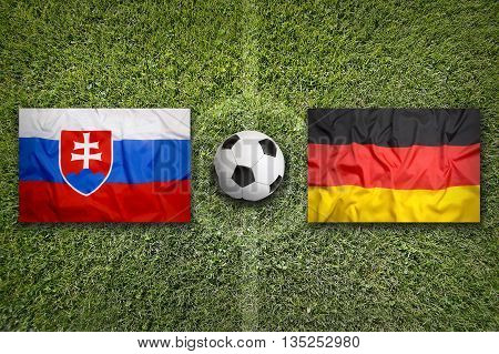 Slovakia Vs. Germany Flags On Soccer Field