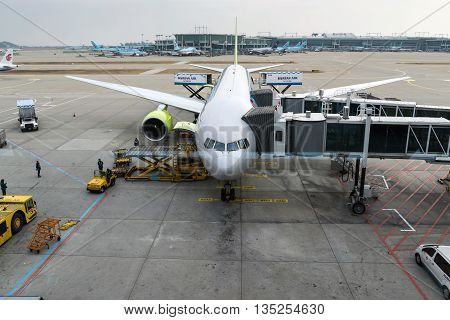 Seoul,South Korea-Jan 6,2016:Officials are checking the plane at  Incheon International Airport in South Korea.