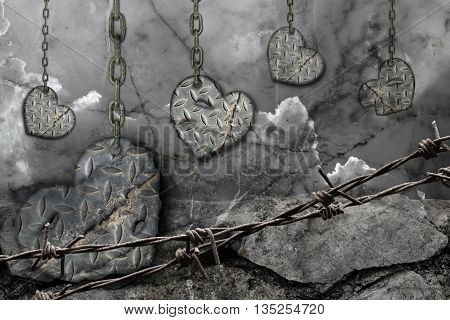 dark toned background hearts of steel with scratches hanging on chains