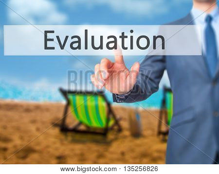 Evaluation - Businessman Hand Pressing Button On Touch Screen Interface.